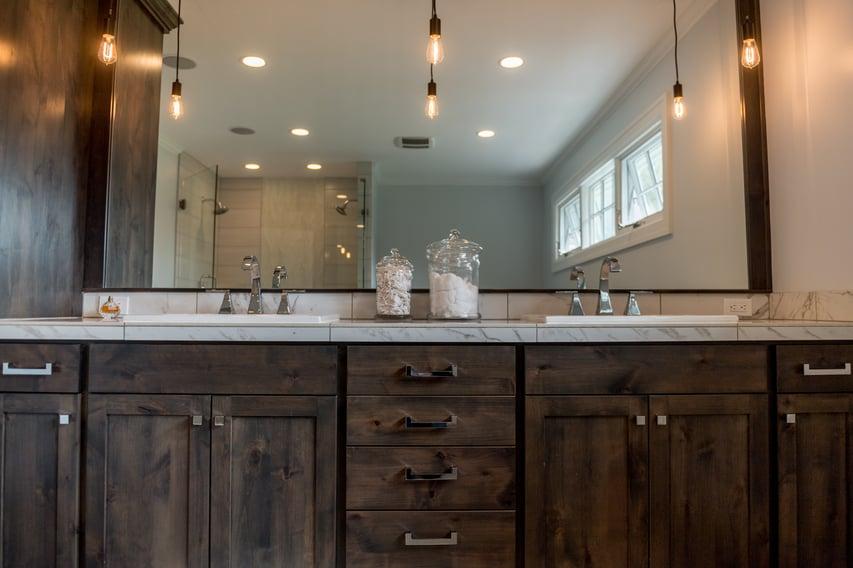 double vanity with dark oak cabinets